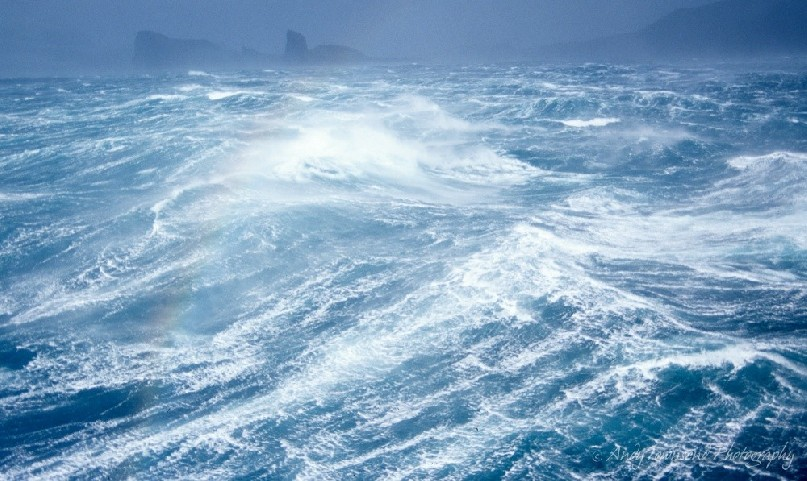 Gale force winds lash the coastline off the coast of Heard island.