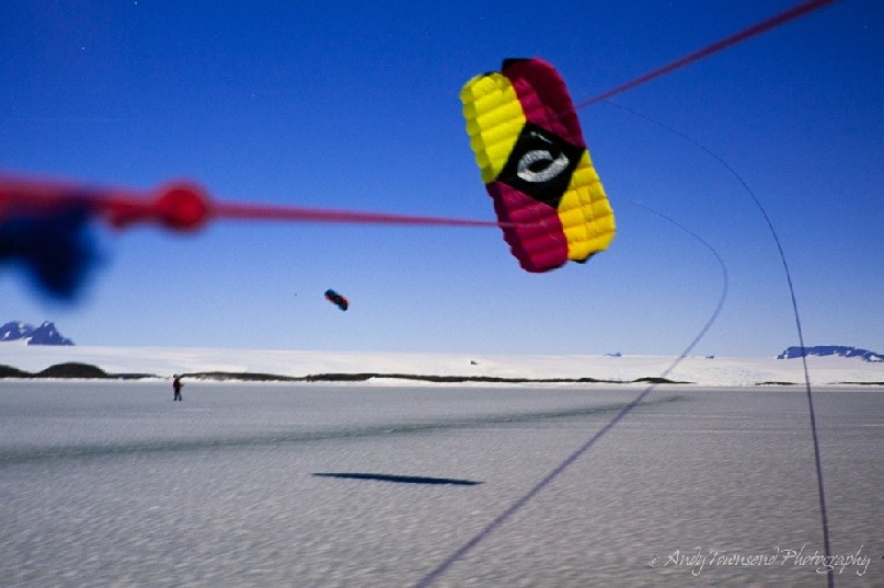 In relatively calm winds it's possible to slow the movement of this kite (quadrifoil) down to photograph it whilst on skis.<br />