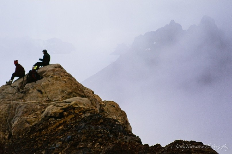 Two companions pause to look at the view in the Masson ranges, Frames Mountains as the mist starts to roll in.