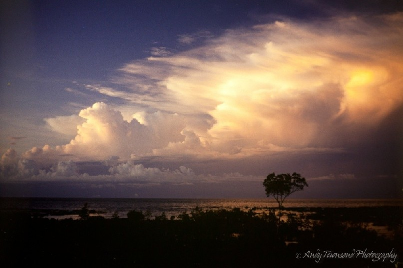 The last of the sun's rays hit storm clouds as they approach Darwin in the build-up season.