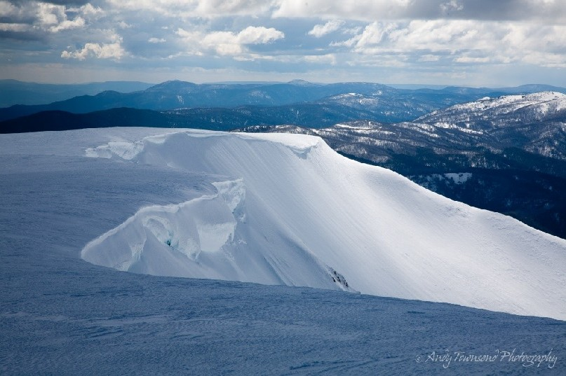 A cornice of snow and ice flanks the northern edge of Watsons Crags on the main range.
