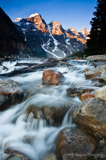 Water cascades down the falls below Moraine Lake in the Canadian rockies.