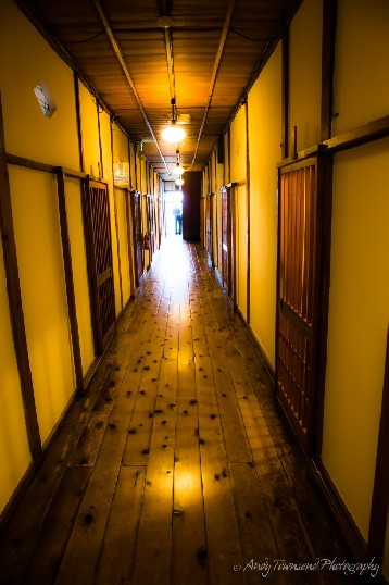 One of many uneven corridors leading through the ryokan with rooms off either side.