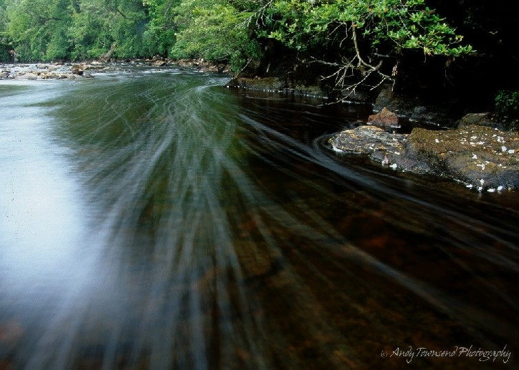 A long exposure shows water bubbles streaming towards the foreground in the upper reaches of the Donaldson River.