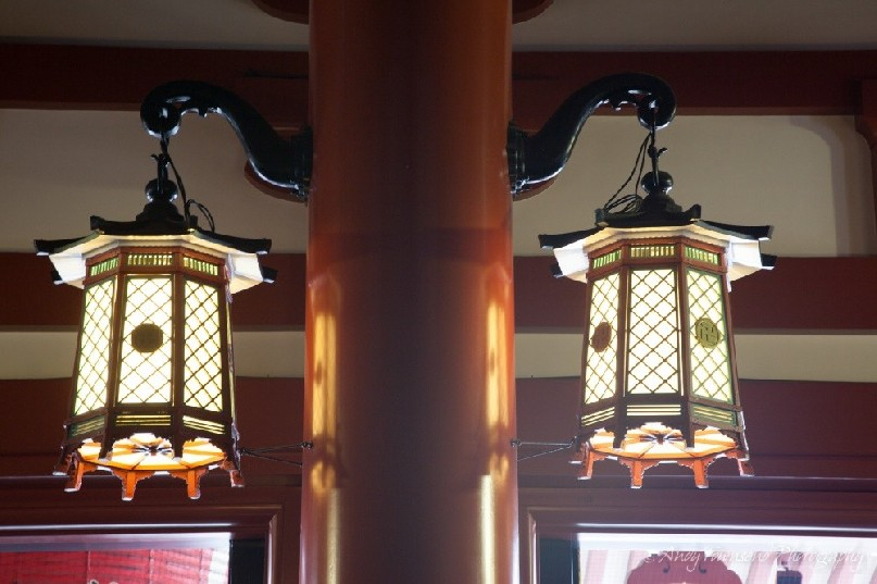 Two ornate lanterns adorn this pole.