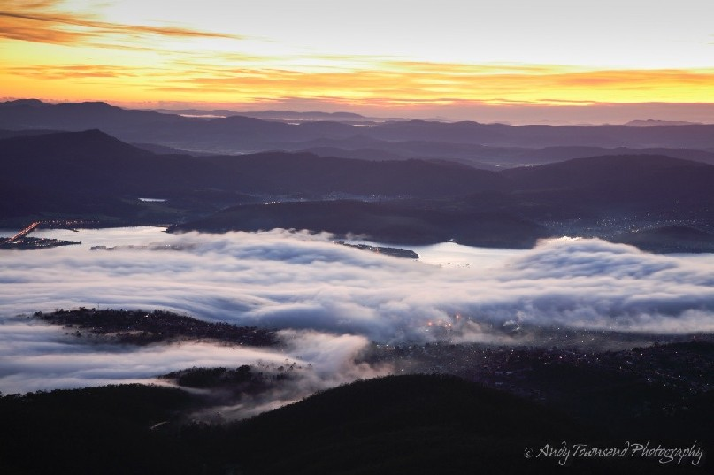 A 'bridgewater jerry' fog rolls over Hobart in the pre-dawn light.