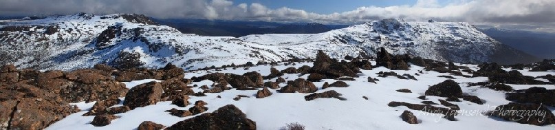 A panoramic view showing the range from Florentine Peak to Mt Field West and the distant vista of the South west wilderness.