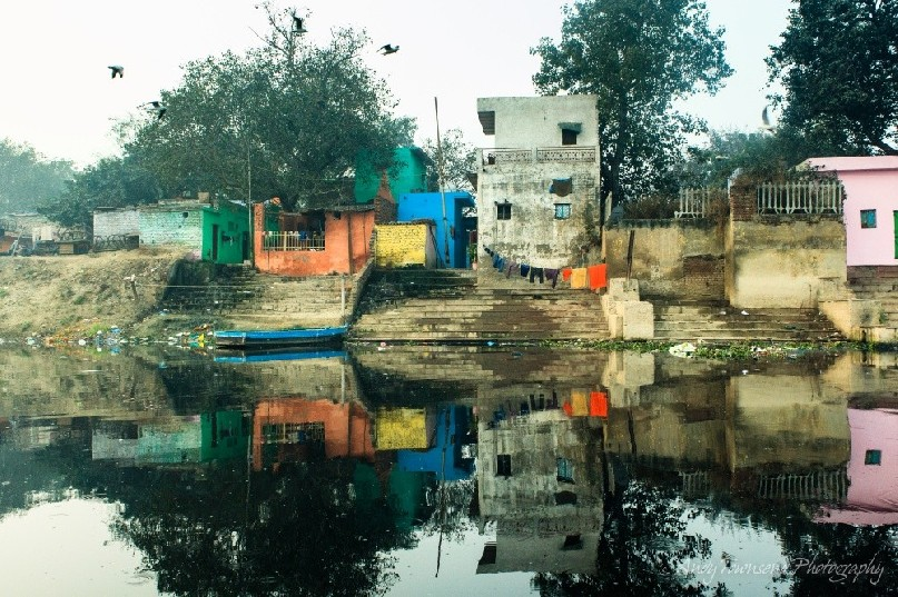 Reflections of old building from the Yamuna river in Delhi.