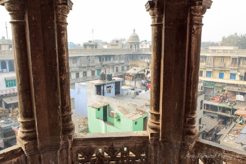 Looking through old stone pillars into the wholesale spice market in Chandni Chowk.