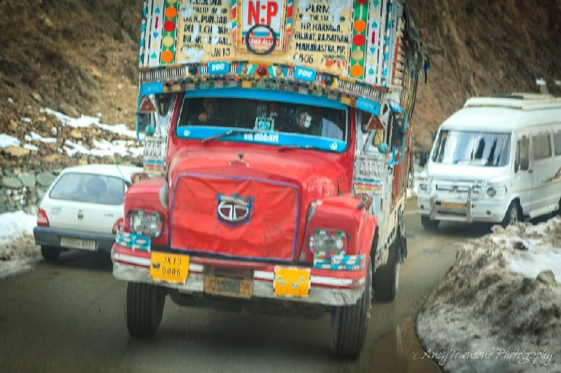 A large colourful truck makes its way towards Tangmarg village.