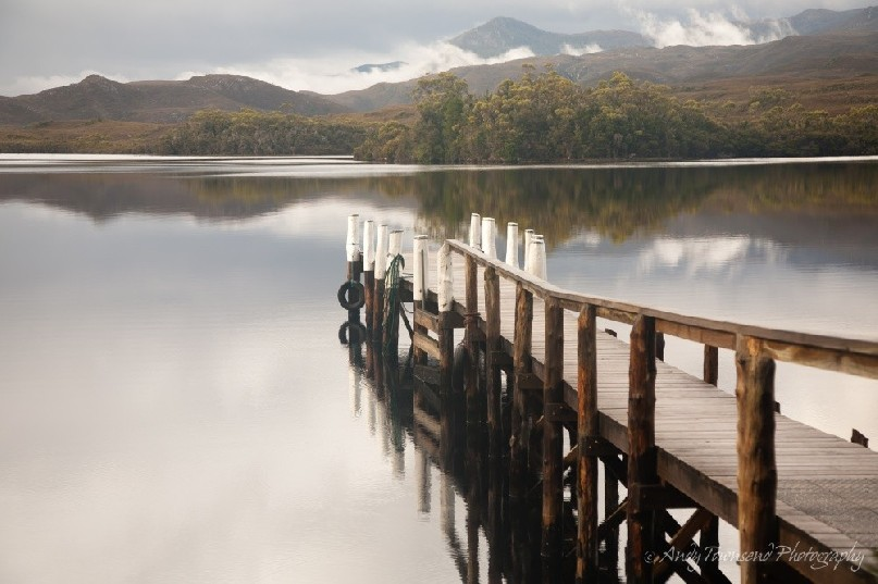 A jetty sits in the quiet tranquil waters in Bathurst Harbour, Southwest National Park, Tasmania.