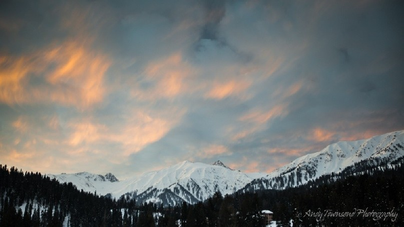 The last of the evening light catches high clouds above the Gulmarg mountain ranges.
