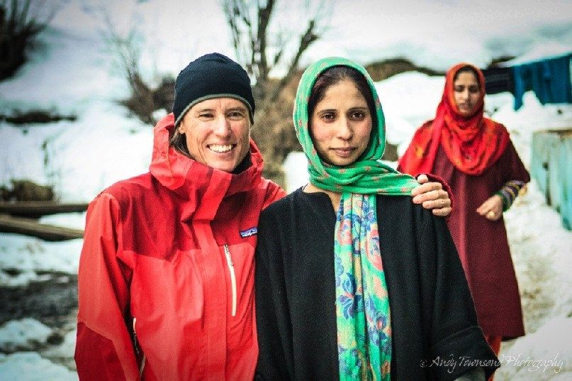 Two woman, a skier and local, enjoy a hug and portrait in Drung village.