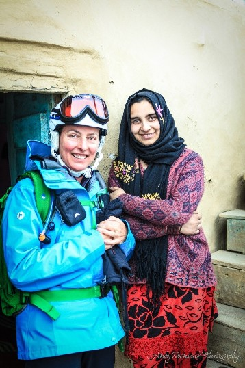 Two woman, a skier and local, enjoy a portrait together in Drung village.