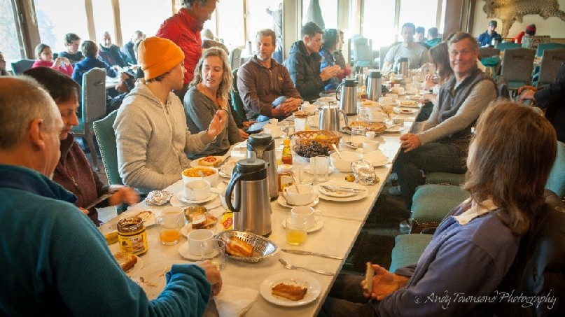 A group of skiers enjoying breakfast.