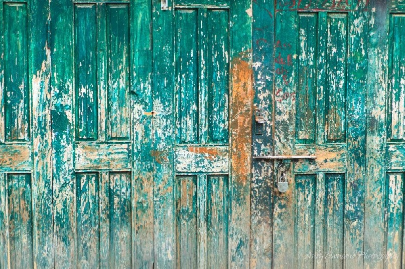 A turquoise wooden door on a house near Drung village.