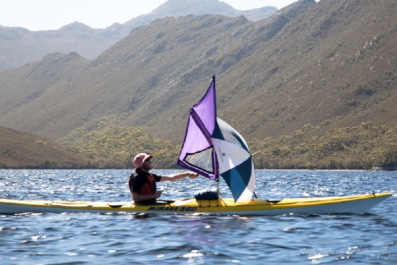 With the relatively recent introduction of sailing to sea kayaking, it's become possible to travel with very little effort. Umbrellas add to the excitement.
