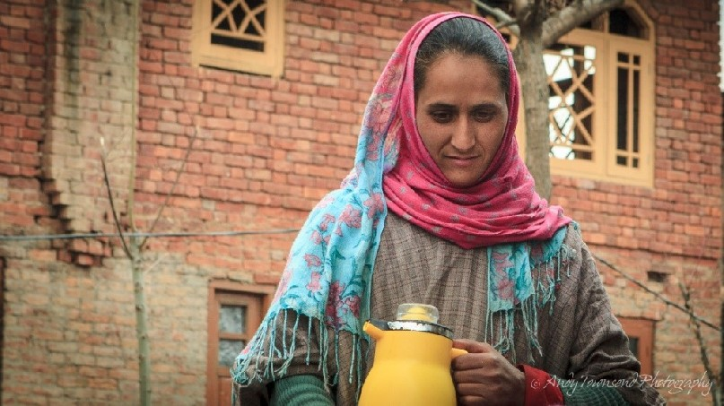A woman prepares to serve Kashmiri tea in the village of Heer, near Targmarg.