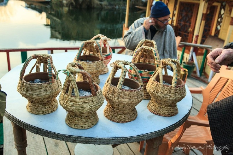 Kangri pots filled with hot embers ready to put under Phirans for an evening trip on Dal Lake.