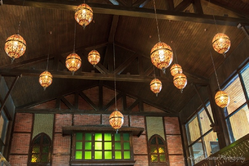 Lights hang from the wooden beams in the hotel lobby.