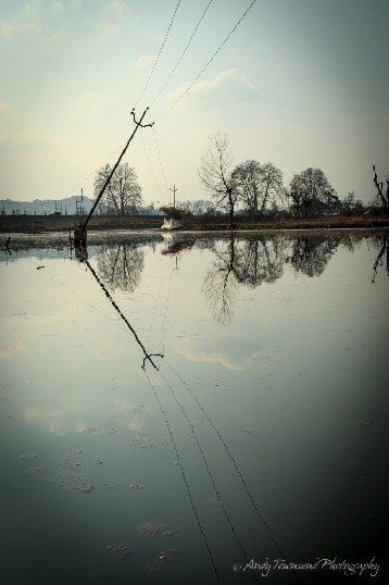 Powerlines reflecting into Dal Lake.