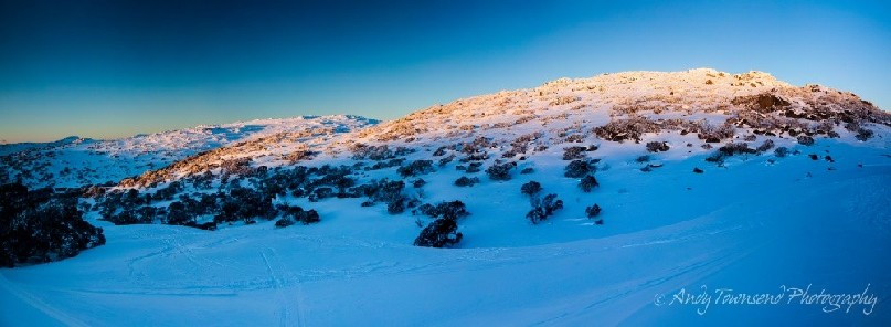 The last of the sun's rays brush over the range near The Paralyser, Kosciuszko National Park, Australia.